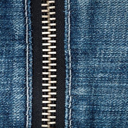 Zipper on a blue jeans photo