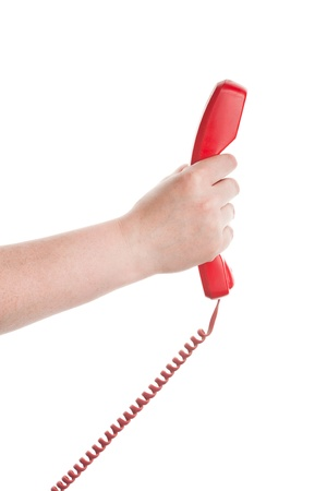 Red telephone receiver in hand isolated on white background Stock Photo - 14075154