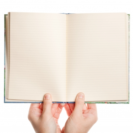 Opened book in hands isolated on white background photo