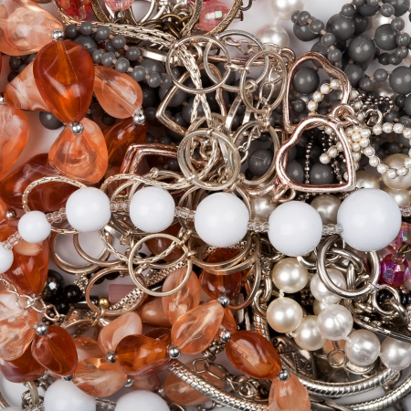 Various mixed costume jewelry background photo