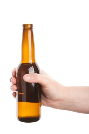 Beer bottle in the hand isolated on white Stock Photo
