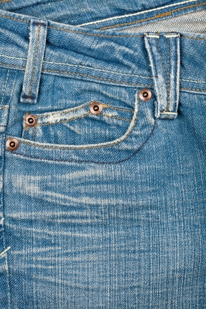 Blue jeans fabric with pocket background      photo