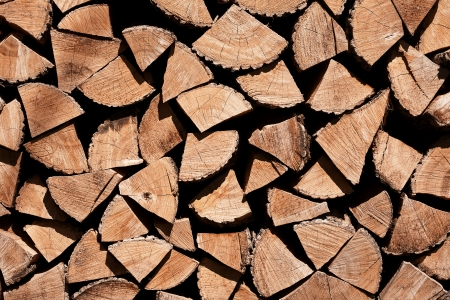 Stacked chopped fire wood texture background photo