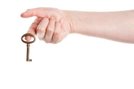 Hand holding old key isolated on white background Stock Photo - 14310892