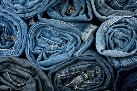Stack of blue jeans as a background or texture  Foto de archivo