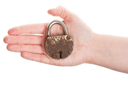 Hand holding rusty old padlock isolated on white photo