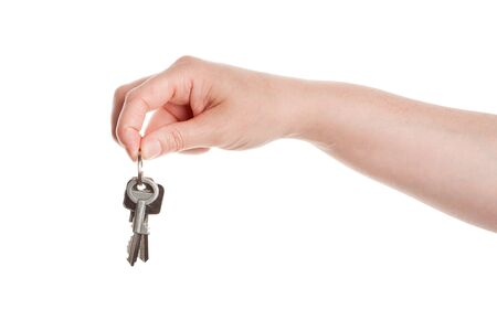 Hand and keys isolated on white background  photo