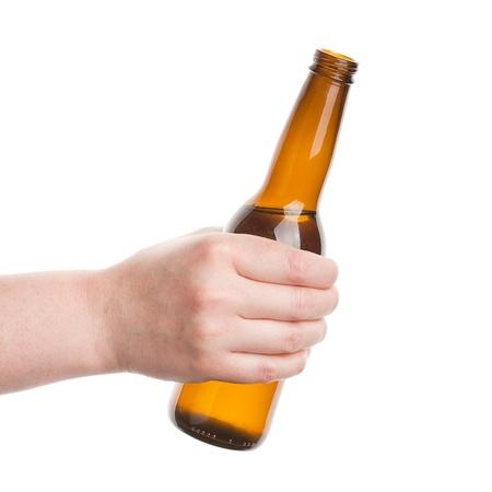 bottle liquor: Botella de cerveza en la mano aislados en blanco Foto de archivo