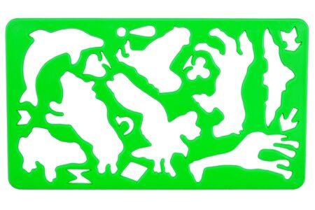 Old green plastic stencil isolated on white photo