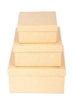 Tower made from cardboard boxes isolated on a white background  photo