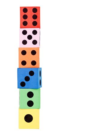 Tower made of colorful foam dice isolated on white  photo