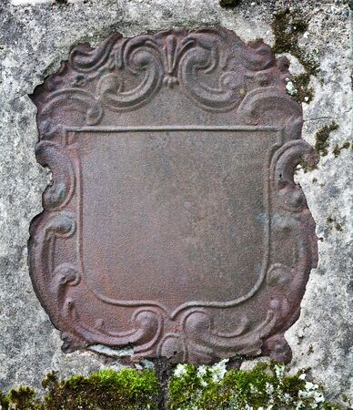 Rusty decorative metal plate in a wall photo