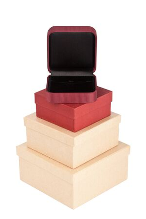 Tower made from cardboard boxes with a jewelry box on top isolated on a white background    photo