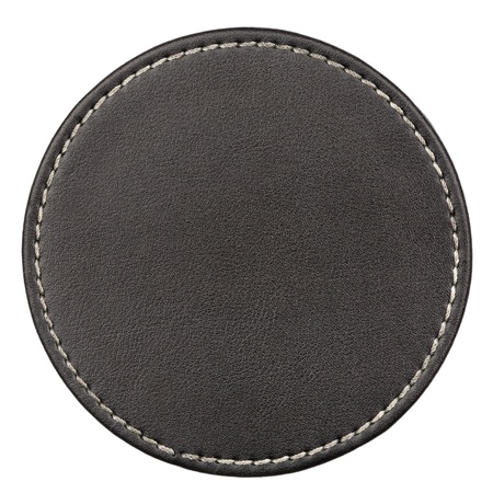 Round black leather table coaster isolated on white photo