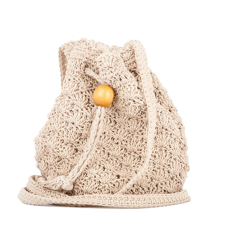Beige knitted handbag isolated on white background.