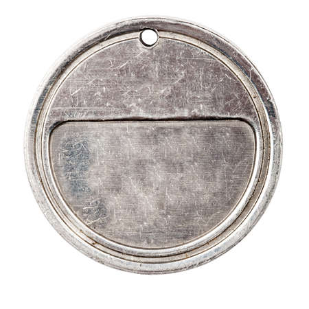 Old grungy medal isolated on white background  photo