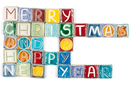 Holidays greeting made from ceramic letters isolated on white photo