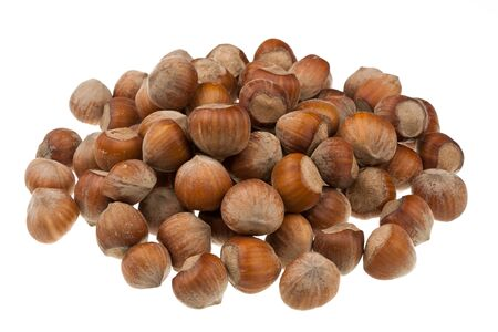 The heap of hazelnuts isolated on white background Stock Photo - 16783935