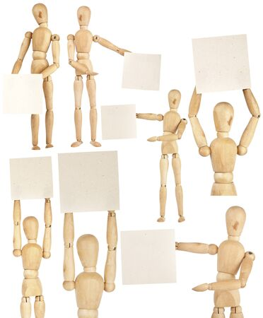 Set of wooden dummies holding handmade paper isolated on a white background photo