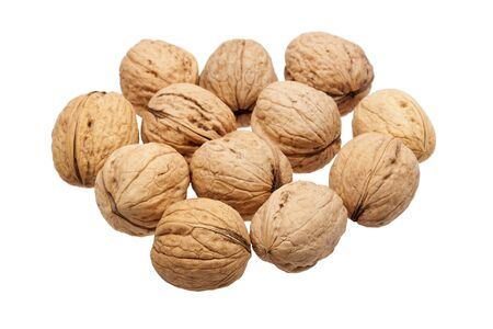Heap of walnuts isolated on white background  Stock Photo - 17466087