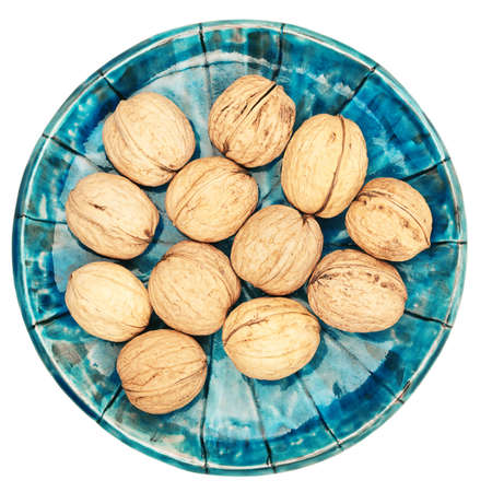 Plate of walnuts isolated on white background Stock Photo - 17466092