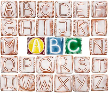 Big size handmade ceramic alphabet isolated on white background  photo