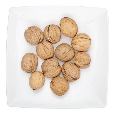 Plate of walnuts isolated on white background   Stock Photo - 17644630
