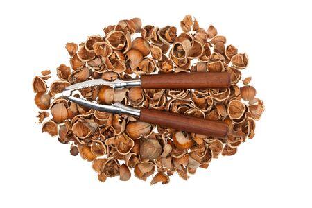 Nutcracker on a pile of empty nutshells isolated on white background Stock Photo - 17627049