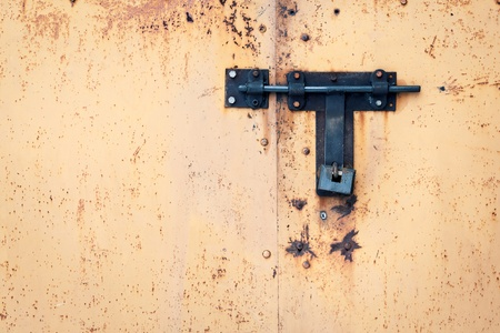 Grunge metal door with padlock   photo