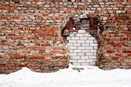 Old brick wall with immured gap in winter Stock Photo - 17779466