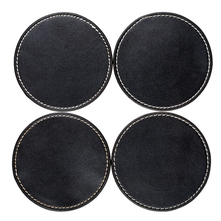 Round black leather table coasters isolated on white Imagens - 17966921