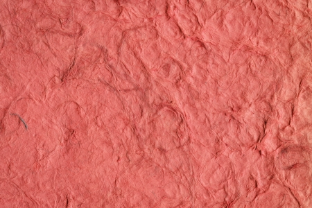 patched up: Red crumpled handmade paper texture