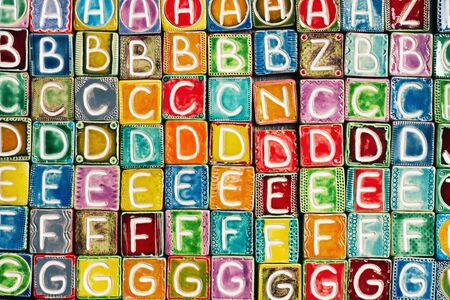 Background from colorful handmade ceramic letters    photo