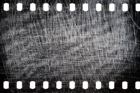 Blank grained scratched film strip texture background  Imagens