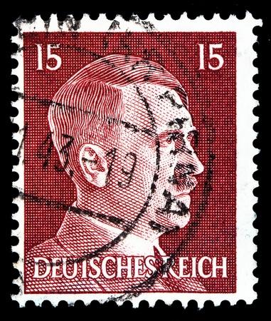GERMAN REICH - CIRCA 1941: A stamp printed in Germany shows image of Adolf Hitler, series, 1941   Stock Photo - 19920245