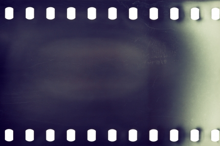 Blank grained film strip texture background photo