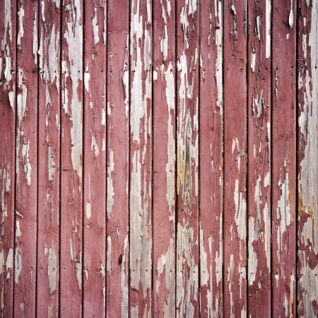 Peeling brown paint on weathered wood texture Imagens