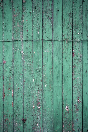 Peeling green paint on weathered wood texture photo