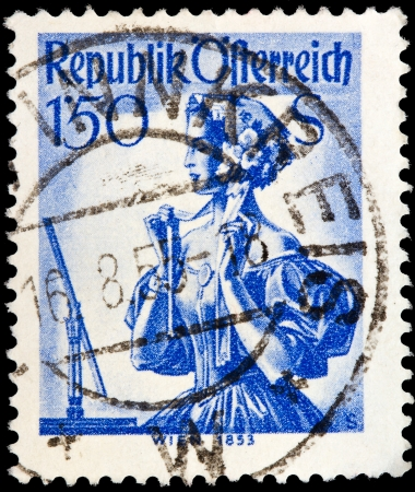 AUSTRIA - CIRCA 1948  A stamp printed in Austria from the  Provincial Costumes  issue shows a woman from Vienna, circa 1948  Stock Photo - 20188191
