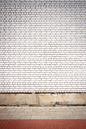 White brick wall and pavement  photo