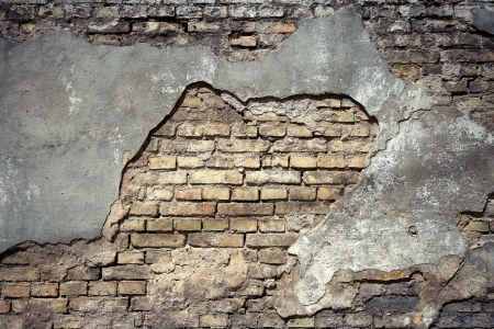 Detail of an old cracked brick wall texture   photo