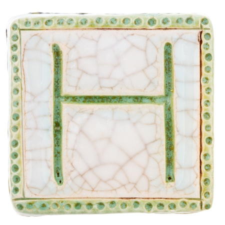 Big size colorful handmade ceramic letter isolated on white background photo