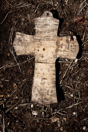 christian symbol: Old wooden cross lying on a ground Stock Photo