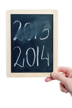 New year concept - hand holding blackboard with 2014 written on it photo