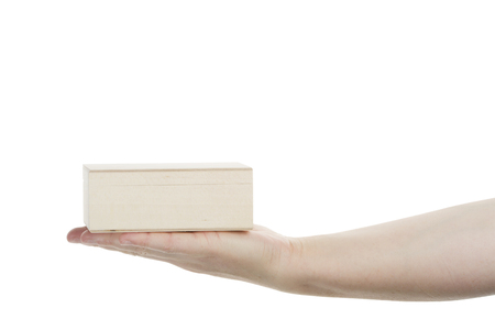 Female hand holding wooden box isolated on white background photo
