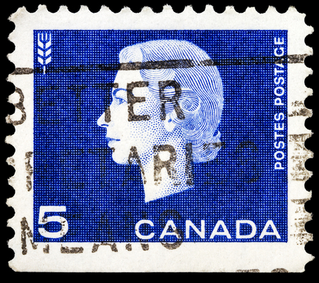 CANADA - CIRCA 1962: A stamp printed in Canada shows a portrait of Queen Elizabeth II and wheat as agriculture symbol, circa 1962.  Editorial