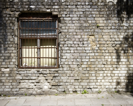 Old cracked wall with a window    Stock Photo