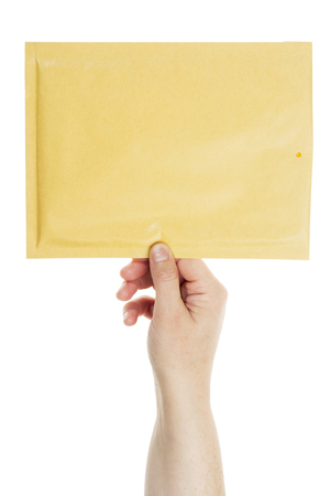 Big yellow envelope in the hand isolated on white  photo