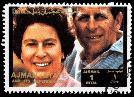AJMAN - CIRCA 1973: stamp printed by Ajman shows Queen Elizabeth and Prince Philip Mountbatten, circa 1973  Stock Photo - 23674301
