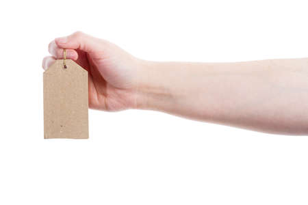 Hand holding blank cardboard tag isolated on white background photo